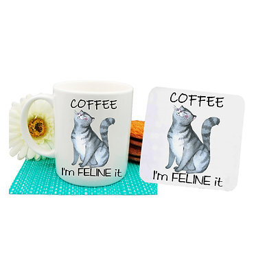 """Ceramic coffee mug and drink coaster set cat with quote """"Coffee i'm feline it"""" image front view"""
