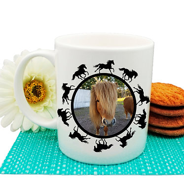 Ceramic coffee mug personalized with photo and round horse pattern boarder around photo front view