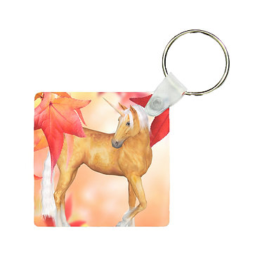 Square wood key ring unicorn in autumn leaves image front view