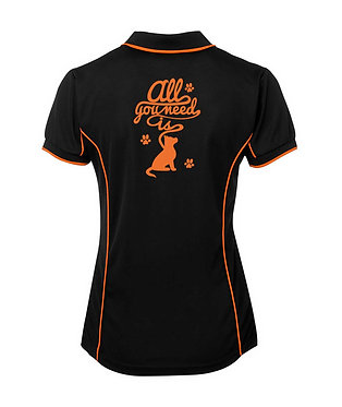 """Black with orange dog image ladies polo shirt with quote """" all i need is"""" back view"""