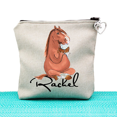 Tan cosmetic toiletry bag with zipper personalised horse sitting cross-legged image front view