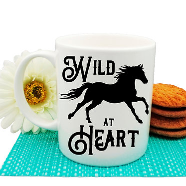 """Ceramic coffee mug with horse and quote """"wild at heart"""" image front view"""