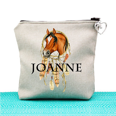 Tan cosmetic toiletry bag with zipper personalised with dream catcher horse image front view