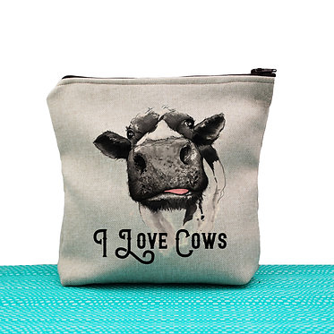 I love cows cosmetic toiletry bag tan fully lined with zip image of a cow on front, front view