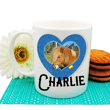 Ceramic coffee mug personalized with photo and text in a denim heart frame front view