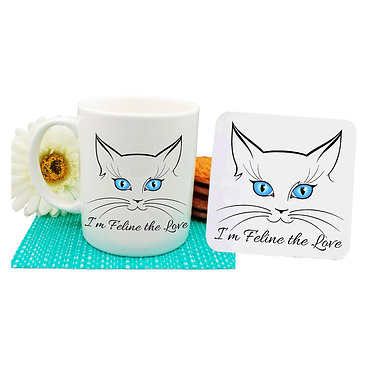 """Ceramic coffee mug and drink coaster set cat face with quote """"I'm feline the love"""" image front view"""