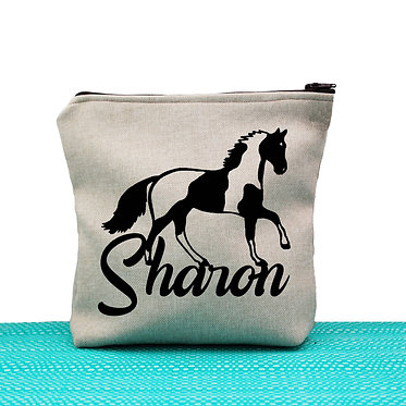 Tan cosmetic toiletry bag with zipper personalized with text paint horse black and white image front view