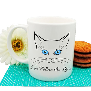 "Ceramic coffee mug cat face with quote ""I'm feline the love"" image front view"