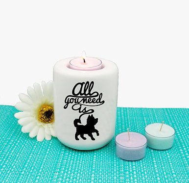 """Dog ceramic tea light candle holder black image with quote """"all you need is"""" front view"""