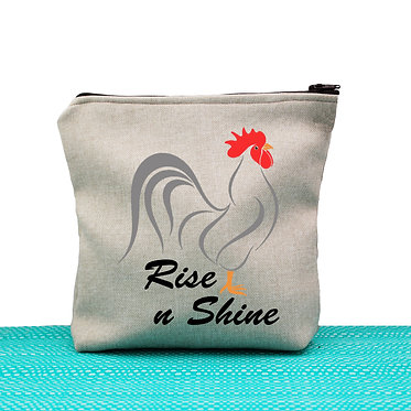 Tan cosmetic toiletry bag with zip and rooster rise n shine image front view