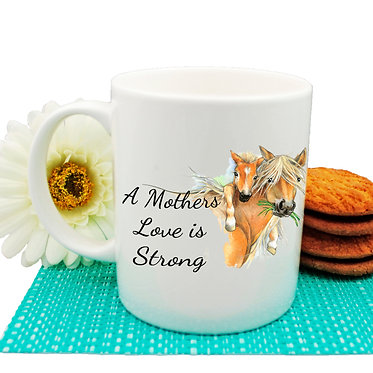 """Horse ceramic coffee mug mare and foal with quote """"a mothers love is strong"""" front view"""