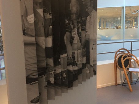 """On one side of the stand is a juxtaposition of an image of nurses co-designing the ideal future patient room using a 3D room layout with furniture, from an article by Liz Sanders & P.J. Stappers """"Co-creation and the new landscapes of design"""" (CoDesign 2008:1), with a 1940s image of a couple testing different ways of furnishing an ideal future home using a similar 3D set-up. The idea with this is to illustrate that the methods that are used in participatory design processes today are not neutral and a-historical, but have come about in specific historical settings."""