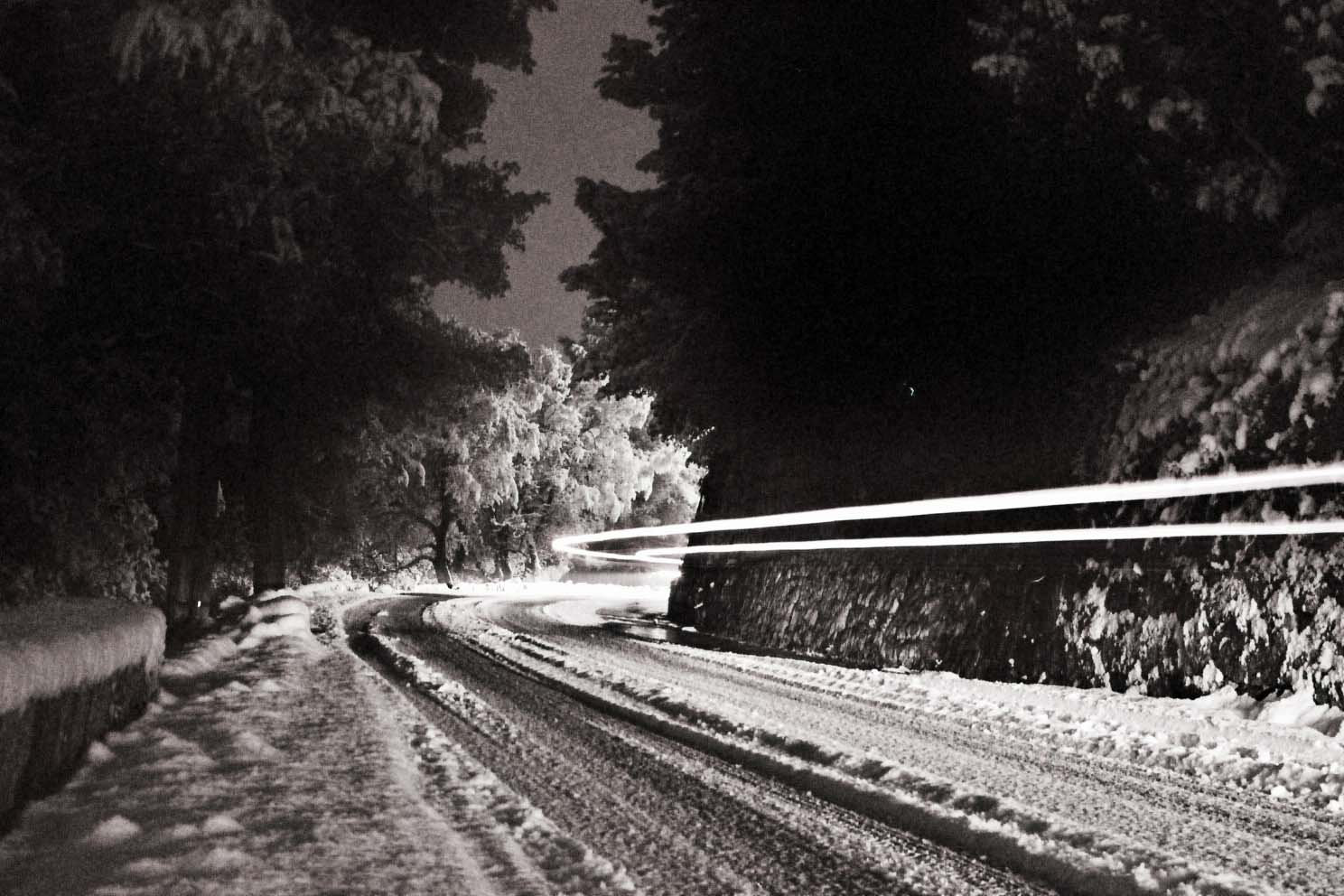 road to Falicon. Nightime long exposure of a car passing by