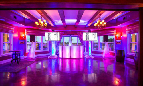Colorful Up-lighting package with DJ booth and Tv's