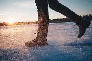 Steps on snow ice foot feet boot sun bac