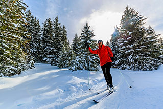Woman cross country skiing on a sunny wi
