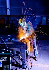 Man welding steel frames