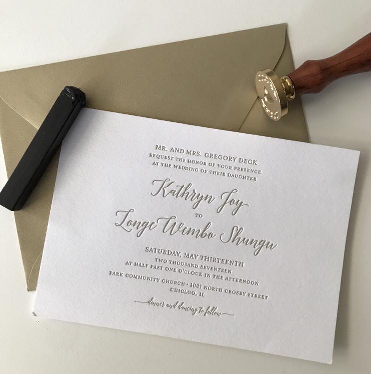 gold letterpress wedding invitaiton