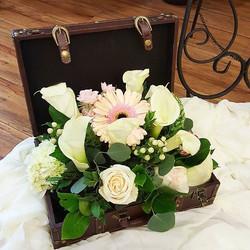 Stunning flower arrangement in brown antique box
