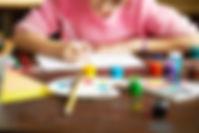 talented-girl-drawing-closeup-MZFU9Y5_s.