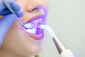 dentist-doing-procedure-with-dental-curi
