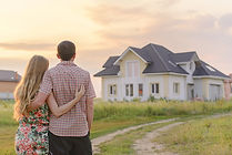 loving couple looking at their home. Cop
