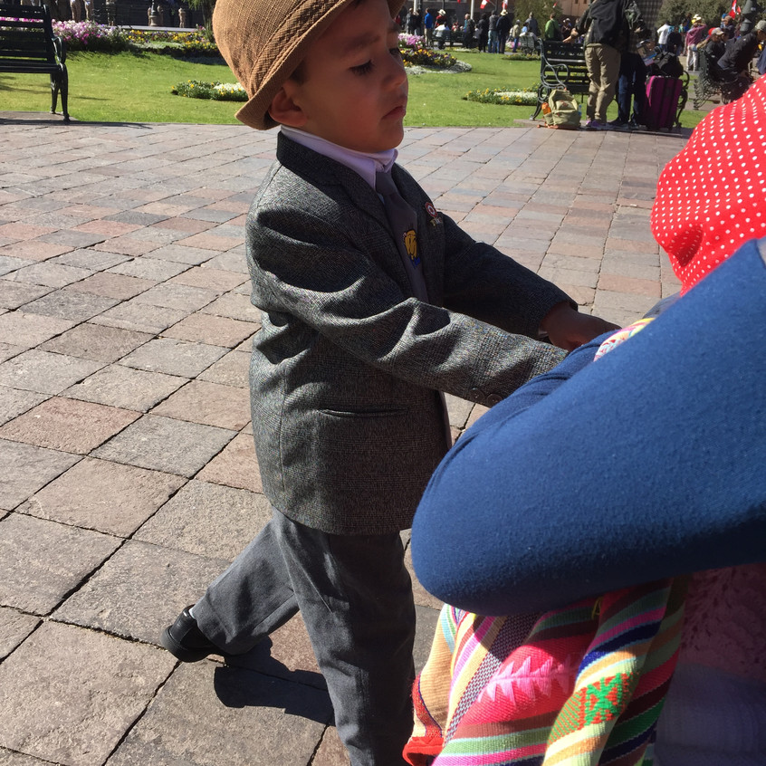 This is her son, dressed in his Sunday best.