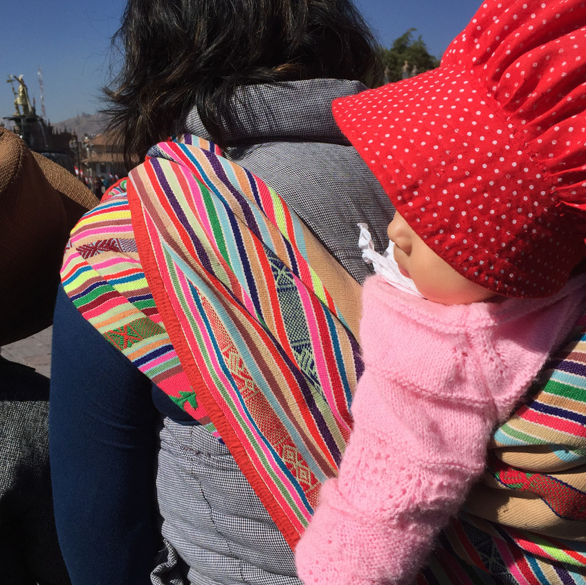 I love how all the women carry their babies n their backs! It's like the trendiest accessory here!