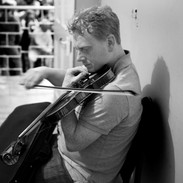Johnny Kelly tuning up before performing in the fiddle recital, 2009. He is the third generation of the Kelly family to teach and play at the Summer School.