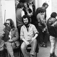 Mairtín Byrnes (fiddle) and Noel Hill seated with Mick Crehan, Breandán Breathnach, Seán and Seán Óg Potts behind them.