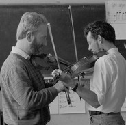 John Kelly Jr. (left) plays a tune with one of his fiddle students, 1985.