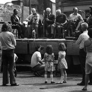 An outdoors concert in Miltown Malbay's main street with (l to r) Michael Falsey, Bobby Casey, Junior Crehan, Seán Reid, Andy Conroy, Pat Mitchell and John Kelly Senior, late 1970s.