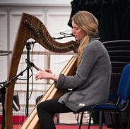 Floriane Blancke performing at the 2017 harp recital.