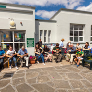 A group of uilleann pipers playing at the opening of the Pipers Plaza.