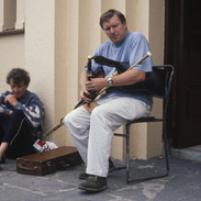 Tommy Keane playing in an outdoors piping recital 1992.