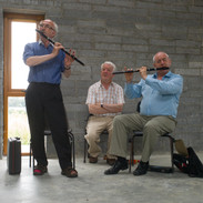 Cathal MacConnell and Marcas Ó Murchú playing for flute students 2013. Mick O'Connor is in the background.