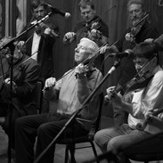 Charlie Lennon (centre) and other fiddle players during the tribute to the late Muiris Ó Rócháin 2012.