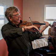 Nicky McAuliffe playing a tune for his fiddle students 2011.