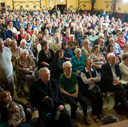 A packed community hall at the tribute to the late Muiris Ó Rócháin 2012.