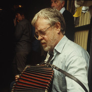 Tony Mac Mahon playing in Quelly's pub 1996.