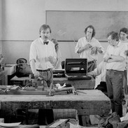 Pipemaker Alain Froment (centre left) in the pipers' workshop, 1989.