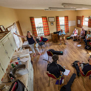 Theresa O'Grady with her banjo students.
