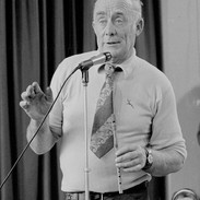 Martin Talty introducing musicians at the tin whistle recital, 1978.