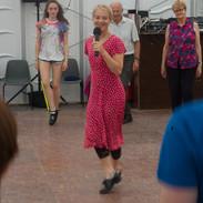 Caroline Reagh demonstrating Scottish dance steps in a special 2017 dance workshop.
