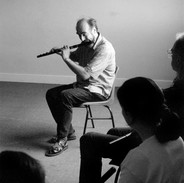 Fintan Vallely demonstrates a tune for his flute students, 1999.