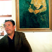Marty O'Malley below a portrait of Willie Clancy.