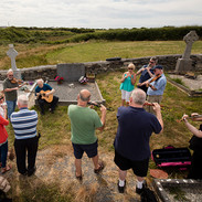 Musicias paying tribute to Bobby Casey at his graveside.