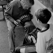Tommy McCarthy with a young concertina student 1992.