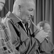 Micho Russell playing at the tin whistle recital, 1978.
