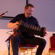 Cormac Ó Beaglaoich performing at the 2019 concertina recital.